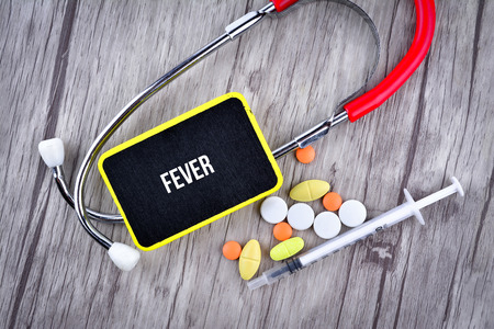 Pills, Syringe and Stethoscope with text FEVER