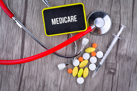 Pills, Syringe and Stethoscope with text Medicare
