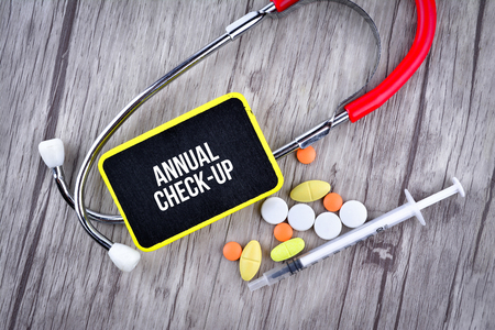 Pills, Syringe and Stethoscope with text Annual Check-Up