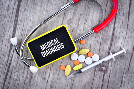 Pills, Syringe and Stethoscope with text Medical Diagnosis