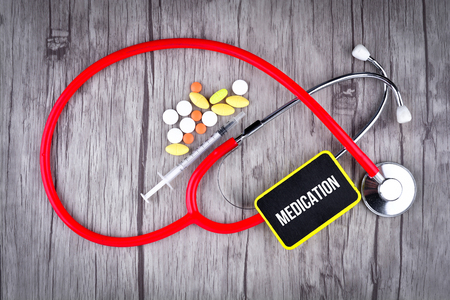Pills, Syringe and Stethoscope with text Medication