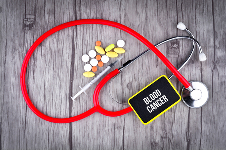 Pills, Syringe and Stethoscope with text Blood Cancer
