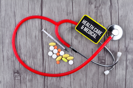 Pills, Syringe and Stethoscope with text Health Care & Medical