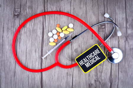 Pills, Syringe and Stethoscope with text Healthcare & Medical