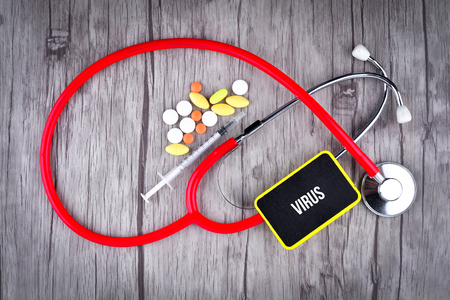 Pills, Syringe and Stethoscope with text Virus