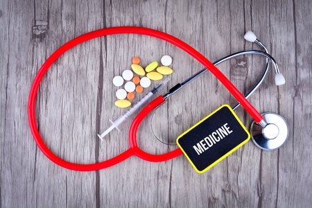 Pills, Syringe and Stethoscope with text Medicine