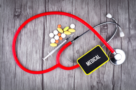 Pills, Syringe and Stethoscope with text Medical Stock Photo