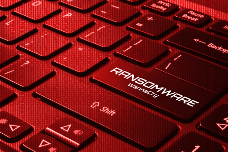 Keyboard with red back light and word RANSOMWARE - WannaCry