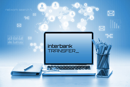 interbank: Open laptop with notebook and smartphone. Banking & Technology Concept