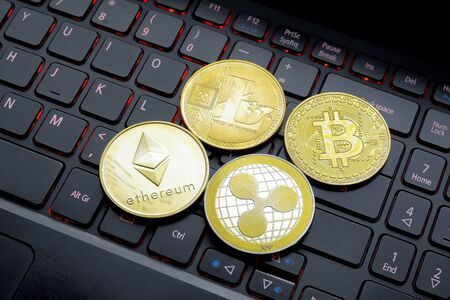 Golden Coins on a laptop keyboard. Cryptocurrency 免版税图像