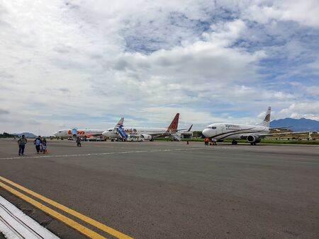 Bandung, Indonesia - November 14, 2018. An airplane with passengers at the Bandung Airport in Bandung, Indonesia. Sajtókép