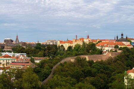 visegrad: view of prague  from vysehrad castle complex captures detail of typical red rooftops as well as hundred towers all over the city