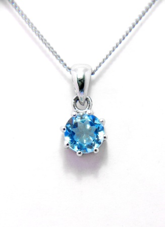 Silver necklace with bright topaz photo