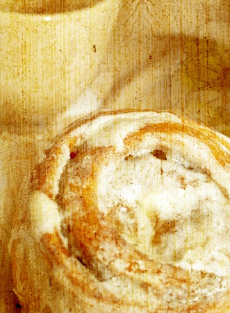Fresh baked cinnamon roll vintage background photo