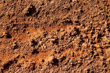 suelo arenoso: La textura de la playa roja de Santorini