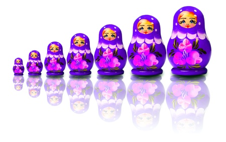 Russian nesting dolls over white background