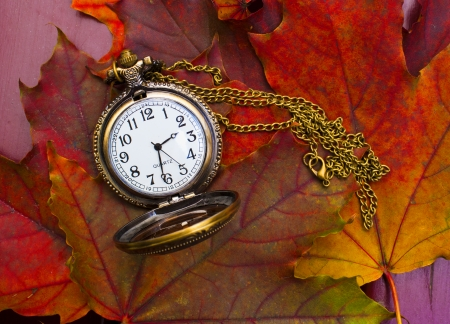Abstract fall background with a pocket watch Stock Photo