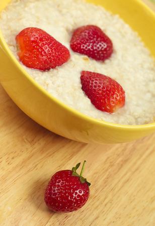 Oatmeal porridge with ripe srtawberries