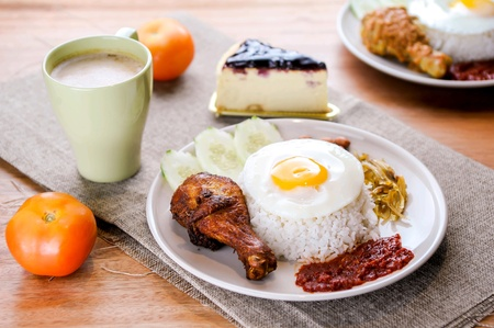 Nasi lemak is Malaysia favourite food which can be eaten with fried chicken or other foods.