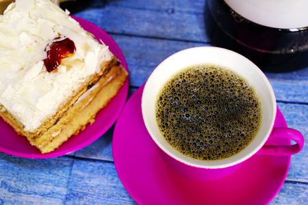 Eastern Turkish sweets baklava and cup of coffee on wooden table