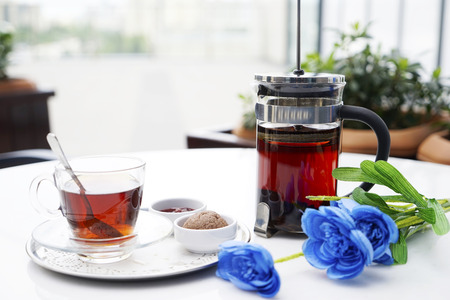 kettle, cups with tea and Eastern Turkish sweets on the table in a cafe