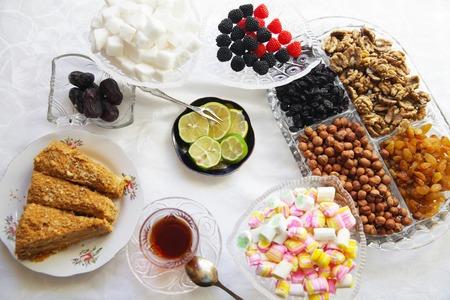 baklawa: Eastern Turkish delight nuts tea on the table Stock Photo