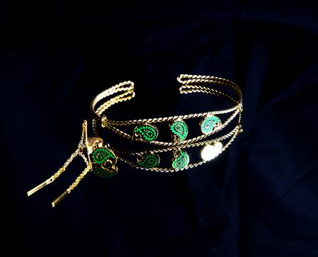 female Golden Eastern Turkish vintage womens handmade jewelry on a black background.earrings, bracelets, rings, pendants