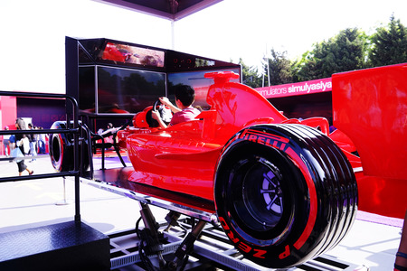 BAKU, AZERBAIJAN - MAY 17, 2016: Public race car Simulator on Ferrari F1 with large audience at Expo Tuning Baku is the premier automotive specialty event in the Azerbaijan on May 17, 2016