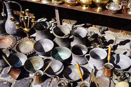 domestic garage: Old kitchenware trays, teapots, coffee turks, samovars, pans plates cups etc Stock Photo