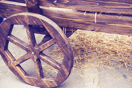 old wooden cart stands in the yard