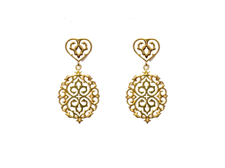 beautiful vintage Oriental gold Turkish jewelry womens earrings in white background Stock Photo