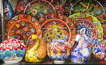 multi-colored decorative Turkish Oriental ornamental ceramic ware on the shelves of the store Stock Photo