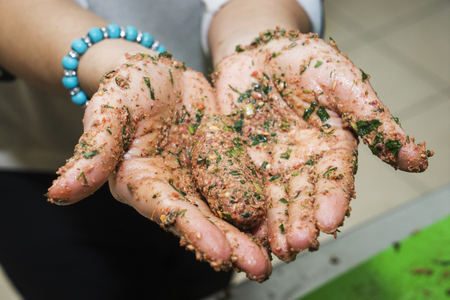 A woman hands cooking vegetarian cutlets Stock Photo