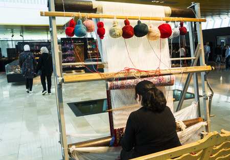 a woman weaving on the loom Oriental Turkish carpet