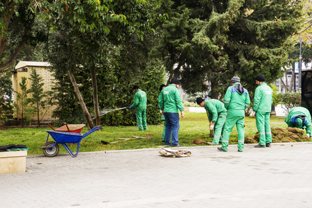 Baku, Azerbaijan-April 16, 2018 gardeners dig up flower beds in the Park, workers working in the Park, people at work, gardeners with shovels