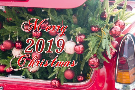 2019 Christmas and new year concepts,An opened red car trunk filled with cloth bags full of gifts and decorations for Christmas. winter