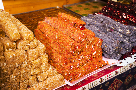 The plate with different variaties of Turkish delight rahat lokum - traditional sweet food, consisting of gel of starch, sugar, dry fruits, nuts, mint, rose water and many others,