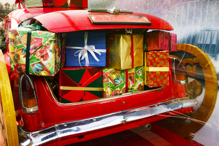 2019 Christmas and new year concepts,An opened red car trunk filled with cloth bags full of gifts and decorations for Christmas.