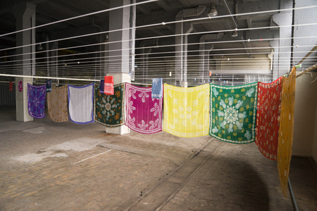 Eastern, Turkish women's silk scarves are dried on ropes