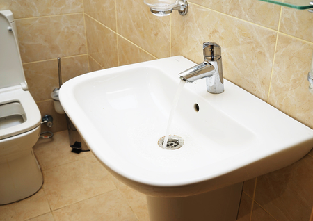 White sink and towell in SPA salon. bathroom.