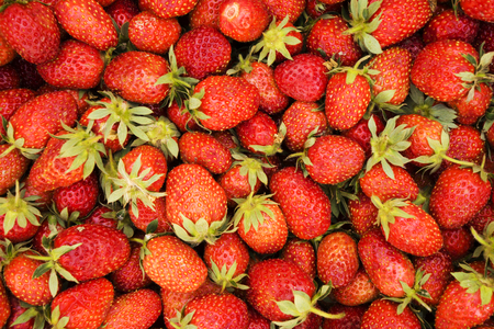 red ripe strawberries for sale on the market counter