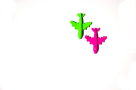 plastik red and green airplane toy on white background.