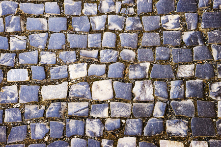 pavement laid out in circles. perspective view. pavement stone gray. stone texture for background. close-up. Abstract cobblestone pavement background