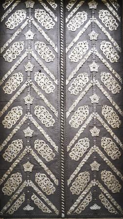 Wrought-iron gates, ornamental forging, forged elements close-up. Reklamní fotografie
