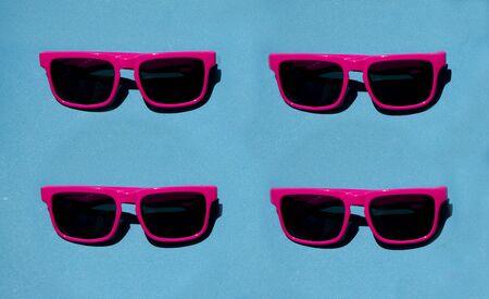 Pink sunglasses pattern on pastel background. Minimal summer concept. Isometric print Stock fotó