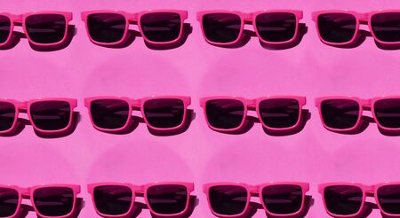 Pink sunglasses pattern on pastel pink background. Minimal summer concept. Isometric print
