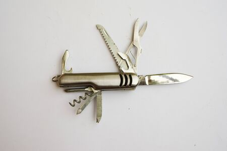 small pocket penknife of stainless steel on a white background. Modern folding knife