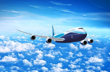White passenger plane in flight. Aircraft fly high in the blue sky over the clouds. Side view of aircraft