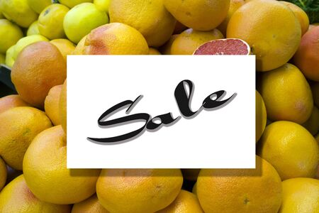 Top view of orange fruit pattern with sale text on frame template background.flat lay design