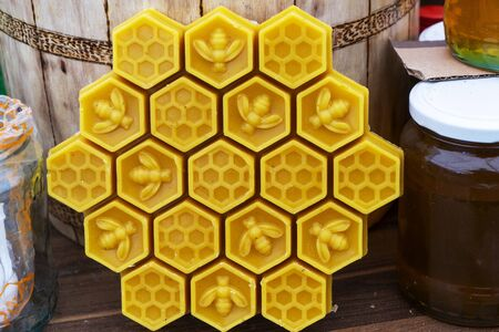 Decorative bee made of beeswax with a honey aroma for interior and tradition. Stock fotó